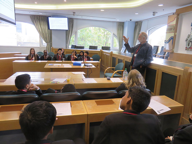 Prof Michael Fielding explains to George Green's students how Alexander Bloom, part of the New Ideals movement, ran St Georges in the East Secondary School (1945-55), Stepney, as a democratic and co-operative community.